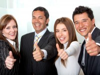 bigstockphoto_Business_Group_With_Thumbs-up_7042463