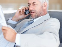 bigstockphoto_Business_Man_Communicating_On__5120319